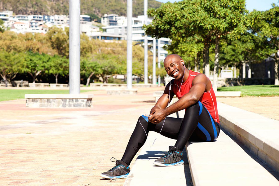 african american man sitting down after a workout