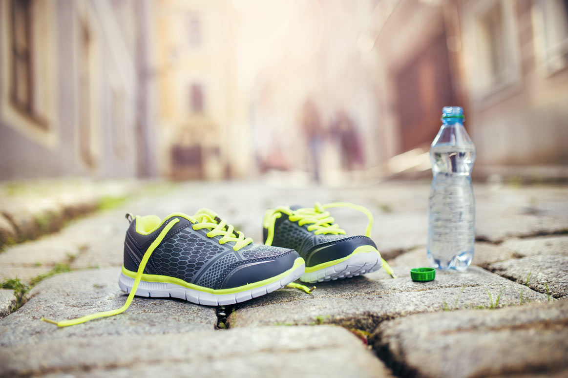 Running shoes and a bottle of water