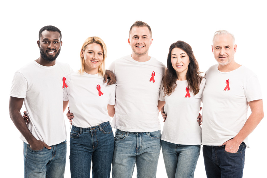 Adults wearing white tshirts with AIDS awareness ribbons