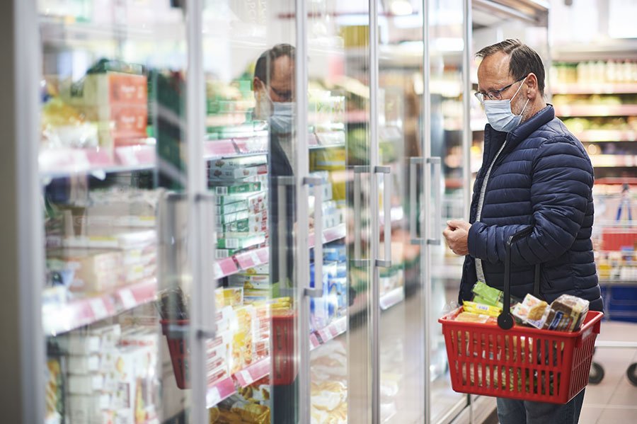 older man wearing face mask in grocery store