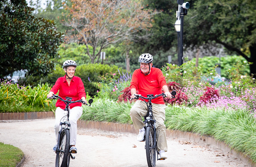 older couple biking in the park