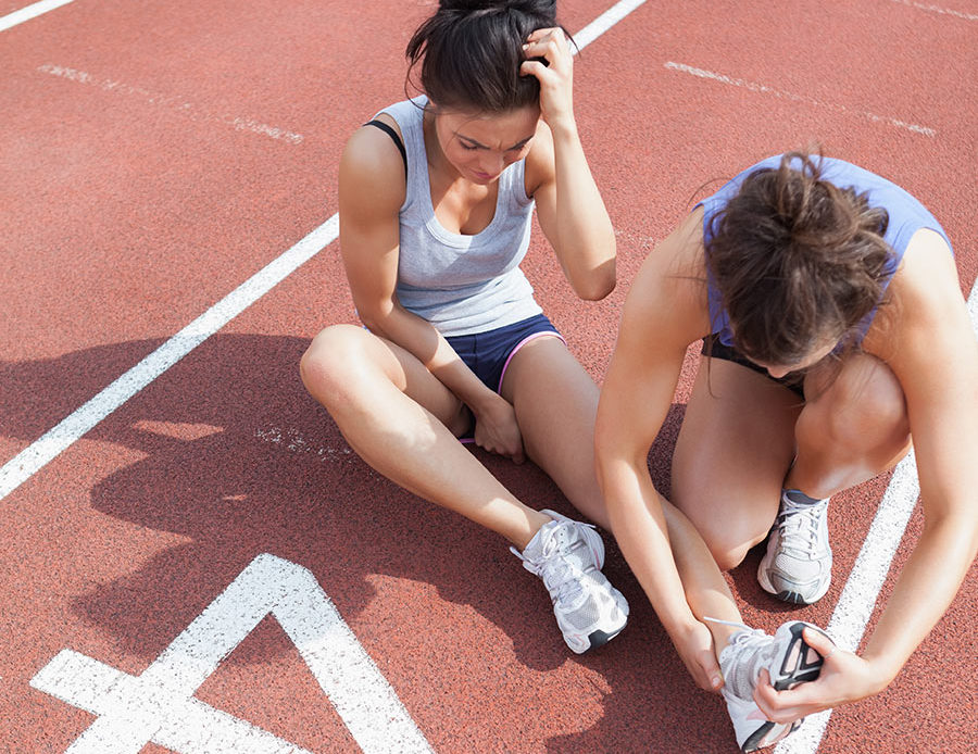 female high school athlete with ankle injury